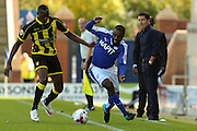 Chesterfield FC manager Dean Saunders looks on as Chesterfield FC forward Sylvan Ebanks-Blake challenges for the ball during the Sky Bet League 1 match between Chesterfield and Burton Albion at the Proact stadium, Chesterfield, England on 26 September 2015. Photo by Aaron Lupton.