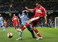 Photo: Paul Thomas.<br /> Manchester City v Middlesbrough. The Barclays Premiership. 30/10/2006.<br /> <br /> Stuart Downing (R) of Middlesborough clears before Micah Richards.