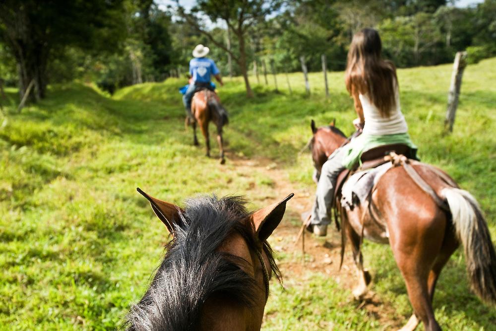 Horseback riding along the trails of a private Hacienda on the side of Volcano Tenario in Costa Rica