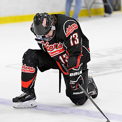 """FORT FRANCES, ON - May 2, 2015 : Central Canadian Junior """"A"""" Championship, game action between the Fort Frances Lakers and the Soo Thunderbirds, Championship game of the Dudley Hewitt Cup. Nolan Ross #13 of the Fort Frances Lakers after the game.<br /> (Photo by Shawn Muir / OJHL Images)"""