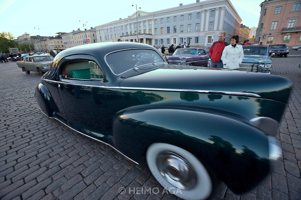 During summer from June to Septemper, every first Friday of the month is Vintage Car Cruising Night. Hundreds of classic American cars cruise around downtown Helsinki and meet at special places to have a good time, here at Kauppatori (Market Square). 1940 Mercury Coupe?.