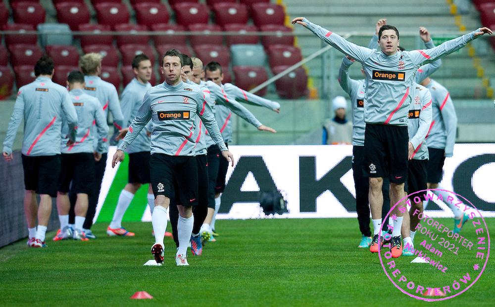 (L) Jakub Wawrzyniak and (R) Robert Lewandowski both of Poland warm up during the training session one day before friendly soccer match between Poalnd and South Africa at National Stadium in Warsaw on October 11, 2012...Poland, Warsaw, October 11, 2012..Picture also available in RAW (NEF) or TIFF format on special request...For editorial use only. Any commercial or promotional use requires permission...Photo by © Adam Nurkiewicz / Mediasport