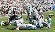 CHARLOTTE, NC - SEPTEMBER 18:  Running back Stephen Davis #48 of the Carolina Panthers dives over the top to score his second touchdown of the game on a one yard run in the fourth quarter against the New England Patriots at Bank of America Stadium on September 18, 2005 in Charlotte, North Carolina. The Panthers defeated the Patriots 27-17. ©Paul Anthony Spinelli *** Local Caption *** Stephen Davis