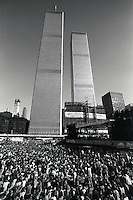1966-1973, New York, New York, USA --- A crowd protests nuclear energy on a plaza in the shadow of the World Trade Center Towers. --- Image by © Owen Franken
