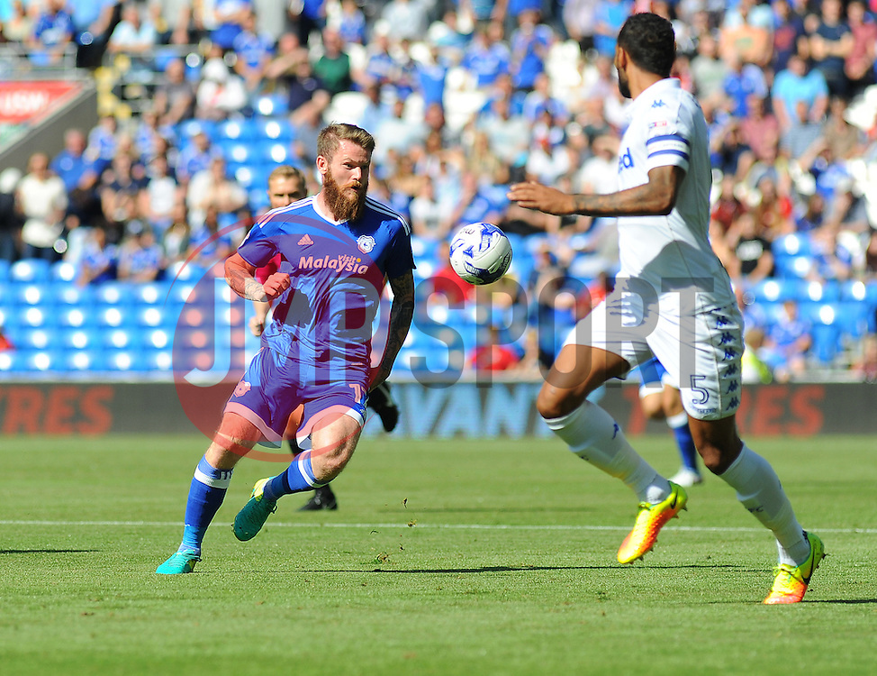 Aron Gunnarsson of Cardiff City trie to get past Kyle Bartley of Leeds United - Mandatory by-line: Nizaam Jones/JMP- 17/09/2016 -  FOOTBALL - Cardiff City Stadium - Cardiff, Wales -  Cardiff City v Leeds United - Sky Bet Championship