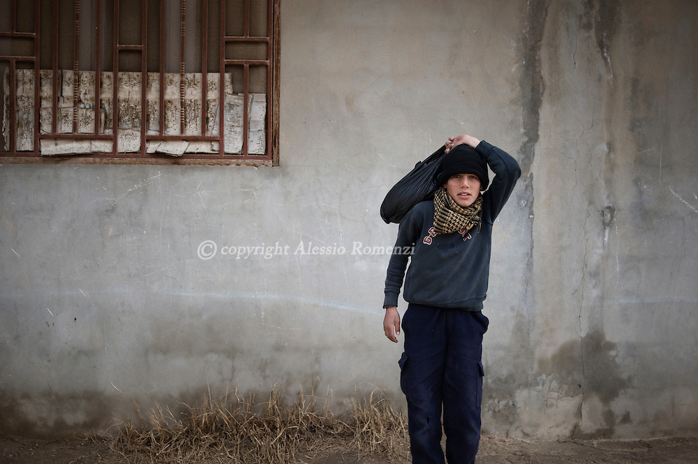 SYRIA - Al Qsair. A child stands in a street as Al Asad Forces are shelling the city of Al Qsair, on February 23, 2012. ALESSIO ROMENZI