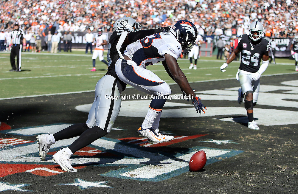 Denver Broncos running back Ronnie Hillman (23) reaches for an incomplete end zone pass broken up by Oakland Raiders outside linebacker Malcolm Smith (53) during the 2015 NFL week 5 regular season football game against the Oakland Raiders on Sunday, Oct. 11, 2015 in Oakland, Calif. The Broncos won the game 16-10. (©Paul Anthony Spinelli)