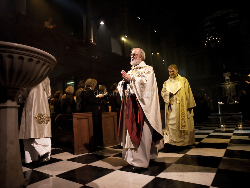 The blessing of an icon by the Archbishop of Canterbury, Rowan Williams at St andrews church in Holborn, london.