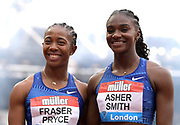 Jul 21, 2019; London, United Kingdom;  Shelly-Ann Fraser-Pryce (JAM), left, and Dina Asher-Smith (GBR) pose after placing first and second in the women's 100m in 10.78 and 10.92 during the London Anniversary Games at London Stadium at  Queen Elizabeth Olympic Park.