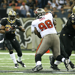 2007 December, 2: New Orleans Saints running back Reggie Bush (25) looks for running room during a 27-23 win by the Tampa Bay Buccaneers over the New Orleans Saints at the Louisiana Superdome in New Orleans, LA.