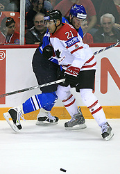 Hannes Hyvonen of Finland v Jamal Mayers of Canada at ice-hockey game Canada vs Finland at Qualifying round Group F of IIHF WC 2008 in Halifax, on May 12, 2008 in Metro Center, Halifax, Nova Scotia, Canada. Canada won. (Photo by Vid Ponikvar / Sportal Images)