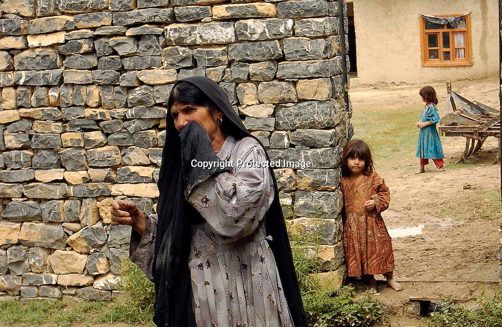 Bibi Mastan talks about her son Dilawar  at their home in the the town of Yakubi in the district of Khost, Afghanistan May 2, 2005. Diliwar, a 22-year-old farmer and part-time taxi driver, died in December 2002 while being held in the main United States air base at Bagram, north of Kabul. His death was ruled a homicide by the Army medical examiner.<br /> <br /> <br /> Photo by Keith Bedford