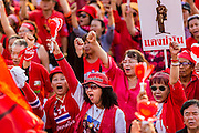 10 MAY 2014 - BANGKOK, THAILAND: Thai Red Shirts cheer for ousted Prime Minister Yingluck Shinawatra at a rally in Bangkok. Thousands of Thai Red Shirts, members of the United Front for Democracy Against Dictatorship (UDD), members of the ruling Pheu Thai party and supporters of the government of ousted Prime Minister Yingluck Shinawatra are rallying on Aksa Road in the Bangkok suburbs. The government was ousted by a court ruling earlier in the week that deposed Yingluck because the judges said she acted unconstitutionally in a personnel matter early in her administration. Thailand now has no functioning government. Red Shirt leaders said at the rally Saturday that any attempt to impose an unelected government on Thailand could spark a civil war. This is the third consecutive popularly elected UDD supported government ousted by the courts in less than 10 years.    PHOTO BY JACK KURTZ