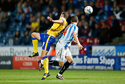 Oriol Riera of Wigan and Mark Hudson of Huddersfield compete in the air - Photo mandatory by-line: Rogan Thomson/JMP - 07966 386802 - 16/09/2014 - SPORT - FOOTBALL - Huddersfield, England - The John Smith's Stadium - Huddersfield Town v Wigan Athletic - Sky Bet Championship.