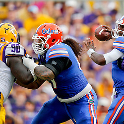 Oct 12, 2013; Baton Rouge, LA, USA; Florida Gators quarterback Tyler Murphy (3) throws a pass against the Florida Gators during the second half of a game at Tiger Stadium. LSU defeated Florida 17-6. Mandatory Credit: Derick E. Hingle-USA TODAY Sports