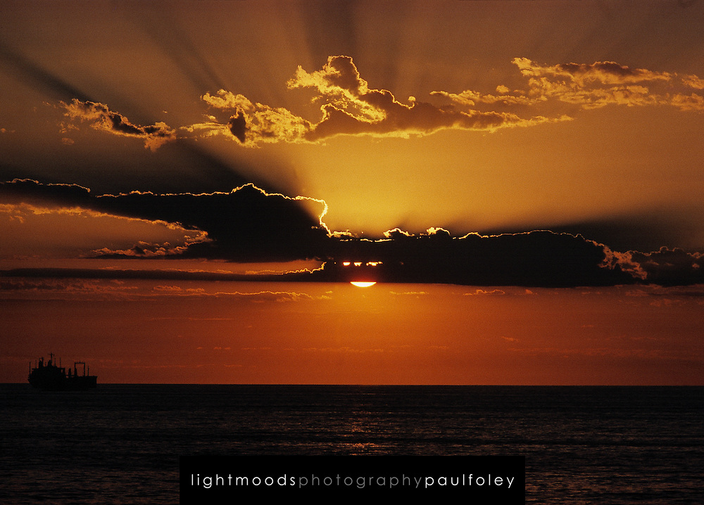 Sunrise over ocean with ship, East Coast Australia