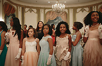 Junior Debutantes Erin Chapman, Isis Franklin, Payton Peebles, Olivia Perry, Sanaia Pierre, and Chloe Phoenix catch a glimpse of their futures as they watch the Links Cotillion Debutantes enter the ball room. The Cotillion develops and celebrates young women of African ancestry by enriching their cultural and economic understanding of the world. |||| Rites of Passage define our lives. They signify the progress of time as well as our citizenship in a tribe, in a culture — in life itself. Chicago commemorates these moments in ways that reflect its diversity, but through difference, we find commonality. We are all connected through these formal and informal ceremonies that remind us how much family, love and time shape us.