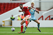 Nottingham Forest forward Daryl Murphy (9)  battles with Burnley defender Ben Mee (6) during the Pre-Season Friendly match between Nottingham Forest and Burnley at the City Ground, Nottingham, England on 29 July 2017. Photo by Jon Hobley.