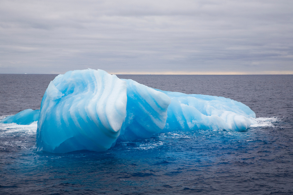 February 11th 2007. Southern Ocean. A melting iceberg reflects the color of the water around it in the Ross Sea.