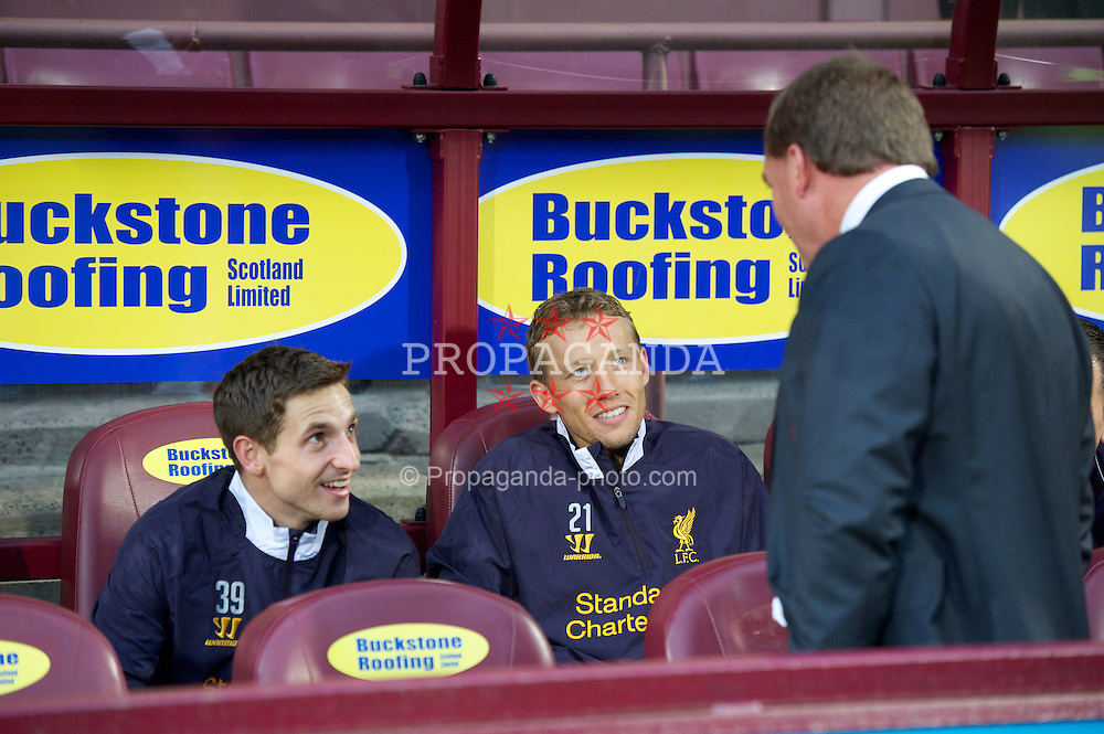 EDINBURGH, SCOTLAND - Thursday, August 23, 2012: Liverpool's manager Brendan Rodgers chats with substitutes Joe Allen and Lucas Leiva before the UEFA Europa League Play-Off Round 1st Leg match against Heart of Midlothian at Tynecastle. (Pic by David Rawcliffe/Propaganda)