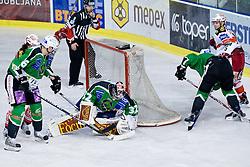 Jan Chabera (HDD Tilia Olimpija, #32) catches the puck during ice-hockey match between HDD Tilia Olimpija and EC KAC in 32nd Round of EBEL league, on December 30, 2010 at Hala Tivoli, Ljubljana, Slovenia. (Photo By Matic Klansek Velej / Sportida.com)