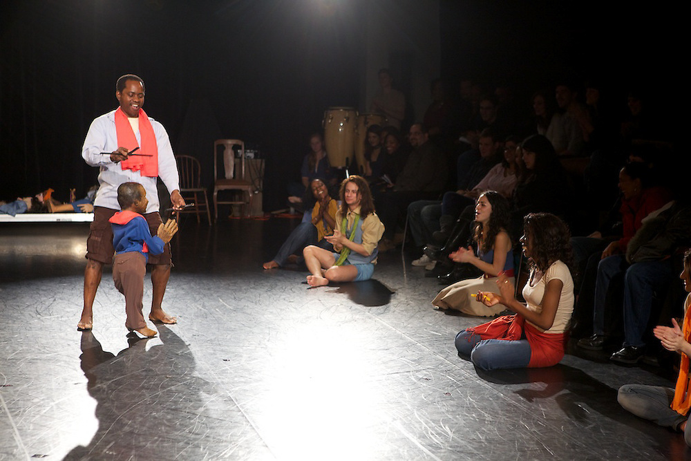 """Who/Nani/Qui, A Concordia Theatre Department production...""""Who/Nani/Qui explores social, cultural, artistic, linguistic, ideological and other commonalities and differences. Through the creative process, under the direction of Rachael Van Fossen, students and a group of guest artists have become artist-anthropologists, studying themselves and each other."""". .Van Fossen said: """"In developing the piece, our ensemble played with the notion that we can perform in 'character' as each other. Through these performances we were able to uncover both differences and commonalities that go beyond the more obvious markers of identity."""". .Who/Nani/Qui includes dance, song and storytelling. Performances range from the improvisational gestural and physical, to highly theatricalized and scripted narratives crossing conventional identity distinctions...Written and directed by Rachael Van Fossen and created with the ensemble and members of the Collectif MOYO..Choreography by Junior Padingani and Kens Mukendi."""