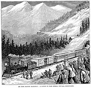 Central Pacific Railraod in the Sierra Nevada mountains. Train cheered by railroad workers, including Chinese labourers. Wood engraving c1875.