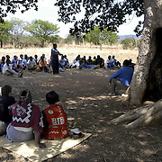 Ludzibini, Swaziland                               October, 2004..A community  meeting is held under a tree in  Ludzibini, Swazliland, October 17, 2004. Photo by Lori Waselchuk/South Photographs