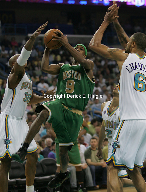 Rajon Rondo #9 of the Boston Celtics drives between New Orleans Hornets defenders David West (left) and Tyson Chandler (right) in the second quarter of their NBA game on March 22, 2008 at the New Orleans Arena in New Orleans, Louisiana.