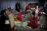 12-10-2007 Kalugumalai Tamil Nadu, India. Children work at home making matches and matchboxes. The girls are put at work in their own homes so the factory owners cannot be blamed for employing child labour. Terres des Hommes Netherlands tries to convince parents to send their girls to school. If they are forced to work anyway TdH provides eveningclasses for the girls.