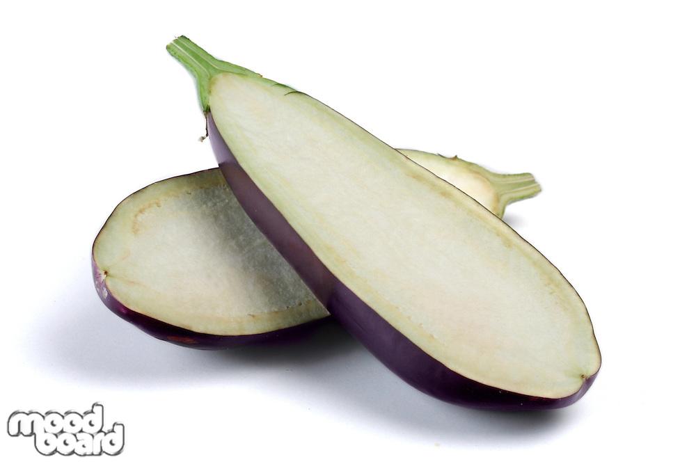 Halved aubergine on white background