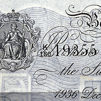 "A detail image of a counterfeit British pound note produced by the Germans in World War II in Operation Bernhard. The image depicted was nicknamed ""Bloody Britannia"" by the counterfeiters for its difficulty to accurately reproduce."