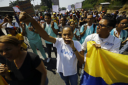 March 26, 2019 - Valencia, Carabobo, Venezuela - Protesters demonstrate against President Maduro for worsening the working conditions at the University.   (Credit Image: © Juan Carlos Hernandez/ZUMA Wire)