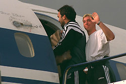 LIVERPOOL, ENGLAND - Monday, September 11, 1995: Liverpool's Neil Ruddock and Robbie Fowler board the Aeroflot Tupolev Tu-154 RA-85715 aircraft at Liverpool Airport before the squad travel to Russia ahead of the UEFA Cup 1st Round 1st Leg match against FC Alania Spartak Vladikavkaz. (Photo by David Rawcliffe/Propaganda)