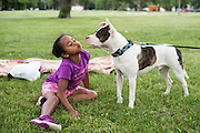 Samya Gatica spends the evening hanging out in Humboldt Park with her dog Rocky Balboa and her parents (not pictured).