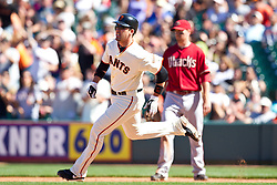 May 30, 2010; San Francisco, CA, USA;  San Francisco Giants first baseman Travis Ishikawa (10) runs to second base on a double against the Arizona Diamondbacks during the ninth inning at AT&T Park.  San Francisco defeated Arizona 6-5 in 10 innings.