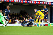AFC Wimbledon attacker Marcus Forss (15) scoring goal to make it 0-2 during the EFL Sky Bet League 1 match between Southend United and AFC Wimbledon at Roots Hall, Southend, England on 12 October 2019.