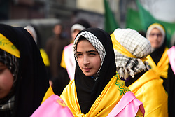 November 21, 2018 - Srinagar, Jammu & Kashmir, India - A Kashmiri Shia Muslim student seen looking on during a march rally marking Eid-i-Milad-un-Nabi, the birth anniversary of Prophet Muhammad PBUH..Muslims across the world celebrated Eid-e-Milad-un-Nabi, the birth anniversary of the Prophet Mohammed on 12 Rabil ul Awal, a month of the Muslim calendar which falls on 21 November 2018. (Credit Image: © Idrees Abbas/SOPA Images via ZUMA Wire)