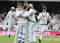 Cricket - 2017 South Africa Tour of England - Third Test, Day One<br /> <br /> The South African players congratulate Wicketkeeper, Quinton de Kock after catching the wicket of Joe Root during the afternoon session, at The Oval.<br /> <br /> COLORSPORT/ANDREW COWIE