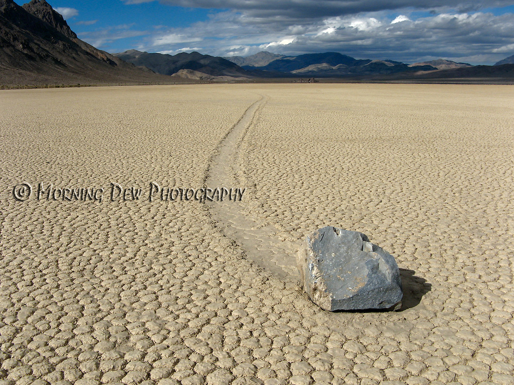 A long trail marks the path of one of the mysterious moving rocks on Death Valley's Racetrack Playa.