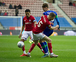 Marley Watkins of Bristol City (C) tackles Kieran Dowell of Wigan Athletic - Mandatory by-line: Jack Phillips/JMP - 11/01/2020 - FOOTBALL - DW Stadium - Wigan, England - Wigan Athletic v Bristol City - English Football League Championship
