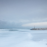Rough seascape with stone jetty