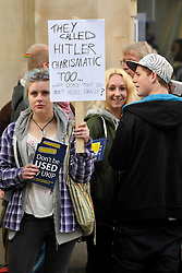 © Licensed to London News Pictures. 29/04/2014; Bath, UK.  Protesters outside as UKIP hold a public meeting with leader Nigel Farage at the Bath Forum.<br /> Photo credit: Simon Chapman/LNP