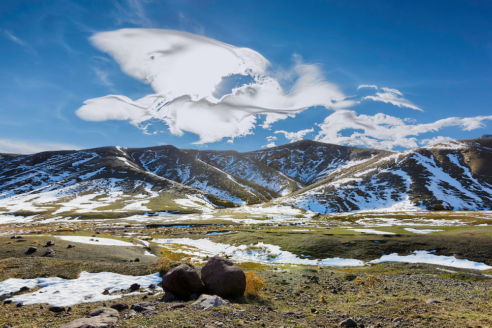 High Atlas Mountains with snow and beautiful clouds.