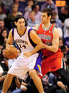 Nov. 21, 2012; Phoenix, AZ, USA; Phoenix Suns forward Luis Scola (14) handles the ball during the game against the Portland Trail Blazers forward Victor Claver (18) in the first half at US Airways Center. The Suns defeated the Trail Blazers 114-87. Mandatory Credit: Jennifer Stewart-US PRESSWIRE