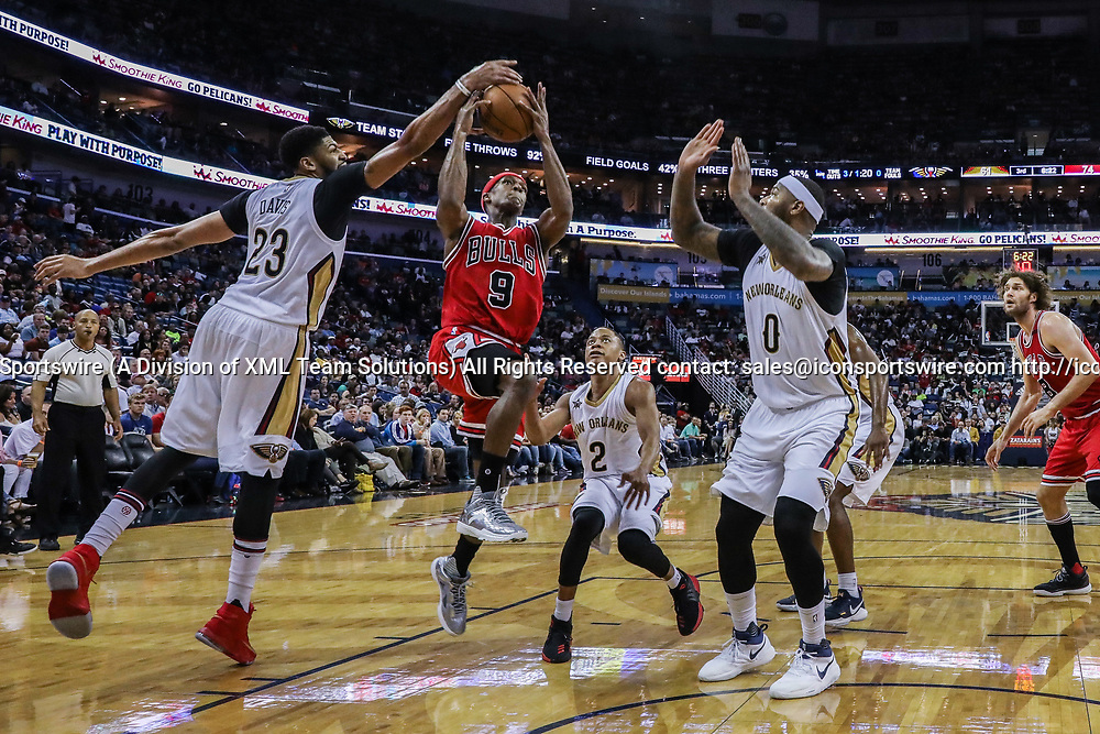 NEW ORLEANS, LA - APRIL 02: Chicago Bulls guard Rajon Rondo (9) has a shot blocked by New Orleans Pelicans forward Anthony Davis (23) during the game between the New Orleans Pelicans and the against the Chicago Bulls on April 2, 2017, at Smoothie King Center in New Orleans, LA.  Bull won 117-110. (Photo by Stephen Lew/Icon Sportswire)