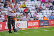 AFC Wimbledon manager Wally Downes watches his team lose a third goal during the EFL Sky Bet League 1 match between Sunderland and AFC Wimbledon at the Stadium Of Light, Sunderland, England on 24 August 2019.