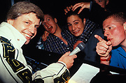 Rowdy teenagers shout-out in mic, Ice Disco, UK, 1997.