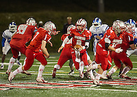 Laconia's quarterback Matt Swormstedt passes the ball to Cody Greenwood during Laconia High School's Homecoming game against Manchester West Friday night.  (Karen Bobotas/for the Laconia Daily Sun)