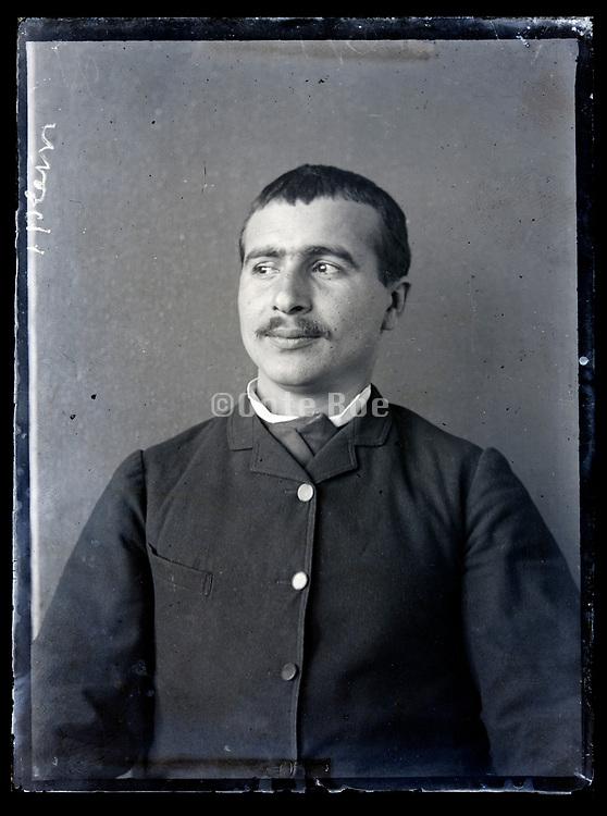 portrait of a man looking sideways circa 1920s